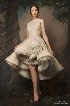 A stunning fashion-forward short gown from Krikor Jabotian's Reincarnation collection featuring unique structure and chic details! » Praise Wedding Community