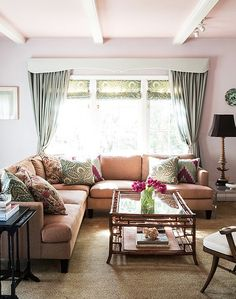 Pale pink walls add a feminine touch.