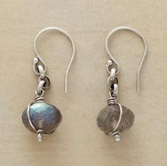 """FASCINATION EARRINGS--Fascinating flashes of iridescence flicker from labradorite rondelles bound in sterling silver. French wires. Handcrafted in USA exclusively for us. 1-1/8""""L."""
