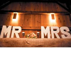 Wooden sign at head table; Photo by Tim Tab Studios.
