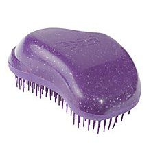 Tangle Teezer Detangling Hairbrush: much needed for the girl child.