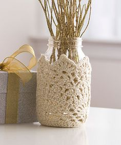 Take an everyday Mason jar from ordinary to extraordinary with a lacy crochet cozy. Perfect for adding a soft touch to your decor or for decorating jars containing food gifts.