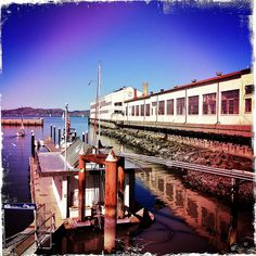 Fort Mason Hipstamatic Reflections – View of the harbor in front of the Fort Mason Center in San Francisco's northern Marina District, with San Francisco Bay and Marin County in the distance.