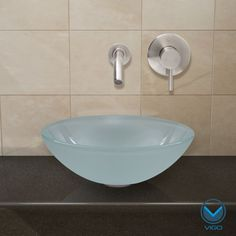 Shop Vigo Flat Edged White Phoenix Stone Glass Vessel Sink with Wall Mount Faucet at ATG Stores. Browse our bathroom sink Top Mount Bathroom Sink, Glass Bathroom Sink, Wall Mounted Bathroom Sinks, Glass Vessel Sinks, Wall Mount Faucet, Pedestal Sink, Bathroom Ideas, Sink Organizer, Phoenix