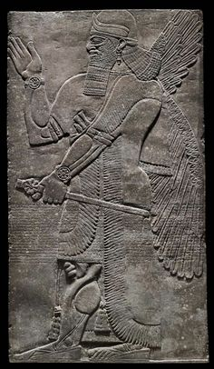 """Slab depicting a winged genius (or """"apkallu,"""" antediluvian sage) holding a mace from the Northwest Palace of Ashurnasirpal II (reigned 883–859 B.C.) in Nimrud. Across the center, the panel is inscribed with the """"Standard Inscription"""" of Ashurnasirpal II.,883-859 BC"""
