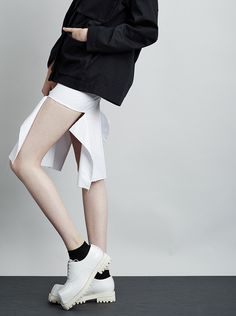 White skirt with open sides & unfinished hem; contemporary fashion details // Yulia Yefimtchuk