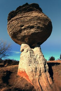 Mushroom Rock State Park, in Ellsworth County, Kansas, features many captivating rock formations called 'hoodoos'. These strange formations are formed through uneven erosion and weathering, giving the rocks the appearance of mushrooms. The small state park offers unique surroundings and has been labelled one of the 'Eight Wonders of Kansas Geography'. The rocks have historically been used by Native Americans and pioneers alike as landmarks and meeting places.