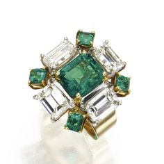 14 KARAT GOLD, EMERALD AND DIAMOND RING. Set in the center with an emerald-cut emerald weighing approximately 2.20 carats, framed by emerald-cut diamonds weighing approximately 3.90 carats, and square emerald-cut emeralds weighing approximately .80 carat, size 5.