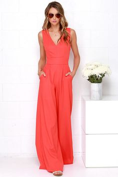 For those days that you want to look fabulous in no time, just step into the Wide Stride Coral Red Jumpsuit! The bright coral red woven fabric shapes a darted V neck bodice with wide straps that crisscross above a cutout at back. The fitted waistline sits atop chic, wide-cut pant legs with diagonal front pockets. Hidden side zipper. Short-length lining. 100% Polyester. Hand Wash Cold.