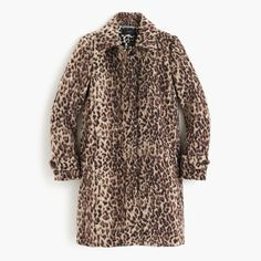 This fuzzy, brushed wool coat layers purfectly (sorry, had to) over your entire winter wardrobe. Plus, special details we like to call inner beauty like a leopard print lining (for double the impact) and a lipstick handkerchief pocket. Body length: 36. Sleeve length: 32. Hits at midthigh. Wool/poly. Half-moon collar. Hidden button closure. Lined. Dry clean. Import. Select stores.