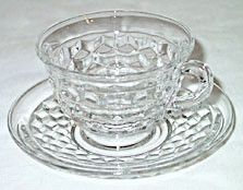 These are Elegant Glass cup and saucer sets in the American pattern made by Fostoria. These are in nice condition with no chips or cracks. .