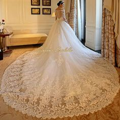 LONG SLEEVE SHOULDER CATHEDRAL BALL GOWN WEDDING DRESS DRESS CAME WITH UNDERSKIRT AND SHORT VEIL DELIVERY IS 10 TO 15 WORKING DAYS FABRICS ENGLISH NET TULLE SATIN LACE PARCHES NET YARN LACE