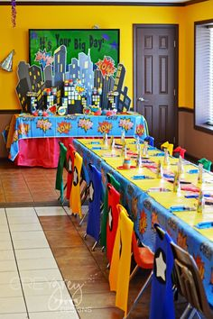 Party planner superhero party... love the capes, the flavored popcorn favors, and cityscape.