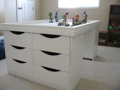 Lego table. Storage for the cool legos and a neat piece. Just two sets drawers on both sides and table top so it wouldn't take up as much space.