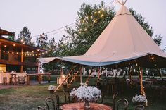 Hello May. Bohemian Style Wedding Reception. Tipi. LARA JARRED