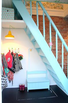 love the open space under the stairs..catchall..