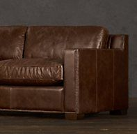 Collins Leather Sofas With Nailheads Restoration Hardware $2700.  Chestnut color leather and grey wall.