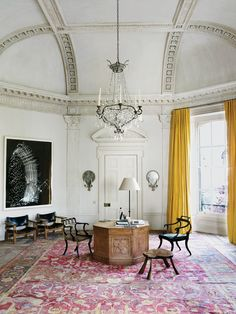 Rose Uniacke's London home, photo Henry Bourne. A Sigmar Polke painting and 17th-century Mughal rug in the study exemplify Uniacke's passion for well-chosen pieces.