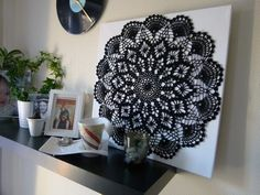 A crochet doily mounted on a canvas, transforming it from a regular doily to crochet wall art.