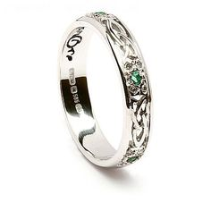 This exquisite Celtic wedding ring is one of our more unusual styles. Our skilled craftsmen have created on the band the design of the Trinity knot, which can represent the father, the Son and the Holy ghost. Between each knot is a vivid green emerald, enhanced by diamond accent stones. This stylish ring is available in either 14k white or yellow gold. Both styles will be hallmarked by the Dublin Assay Office, your assurance of quality. Enda is from the word ean, meaning bird and can…