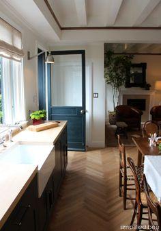 farn house kitchen sink  // herringbone wood floors  // kitchen door