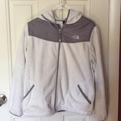 The North Face fleece White North Face hooded jacket. I'm usually a small in adult North Face but this youth XL fits me nicely. The North Face Jackets & Coats