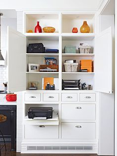 This storage-smart built-in is ideal for holding home office supplies. See the rest of this renovated home: http://www.bhg.com/home-improvement/remodeling/before-and-after/farmhouse-renovation/?socsrc=bhgpin051713builtinofficestorage=7