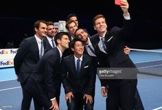 Tomas Berdych of the Czech Republic takes a group selfie of Stan Wawrinka of Switzerland,Milos Raonic of Canada,Novak Djokovic of Serbia,Kei Nishikori of Japan,Andy Murray of Great Britain,Roger Federer of Switzerland and Marin Cilic of Croatia after the mens singles official group shot had been taken prior to the start of the Barclays ATP World Tour Finals tennis previews at the O2 Arena on November 7, 2014 in London, England.
