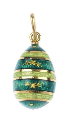 FABERGE - an 18ct gold enamel egg pendant. Designed as a series of green guilloche enamel bands, with foliate detail. Signed and numbered Faberge 13/300. Import marks for London, 1998. Length 2.5cms. Weight 7.2gms.