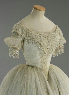 1860s ball gown, the detail is amazing.  Imagine how this sparkled in the candlelight!|| Dressgasm. I want this so bad. Look how perfect that point is creating a fold in the skirt...Creating a point that sharp and perfect on a dress just went on my bucket list lol