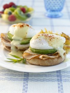 Eggs Benedict withAvocado - Eggs Benedict with turkey and avocado, served on warm English muffins are a great way to start your day
