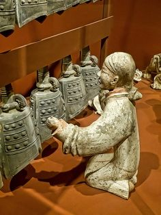 Closeup of Musician playing the bells Western Han Dynasty China 206 BCE-9 CE Painted Earthenware