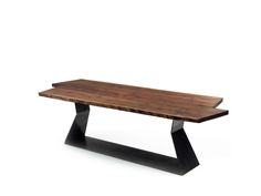 """The top, made of solid walnut wood, featuring 5 cm-thick natural sides, perfectly marries the raw-iron base that is hand-shaped and soldered.top with asymmetric short-sides.The tops of tables requested """"with knots"""" are treated with a special black-coloured wax that is heated and once liquefied, it is poured onto the knot. Time is allowed for the wax to cool down at room temperature. Once it solidifies, it thoroughly covers up the wood knot. It is possible to encounter wax """"crystallization""""…"""