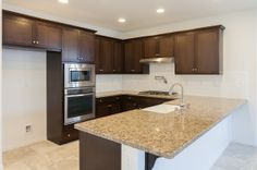 Spacious open Kitchen with granite counter top and stainless steel appliances.