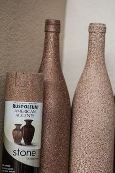Wine bottle craft: use stone textured spray paint to create a candle holder or a vase. You could also texture the bottle and then spray it with a metallic spray for a high-end look. Wine Bottle Corks, Wine Bottle Crafts, Diy Bottle, Bottle Vase, Glass Bottles, Empty Liquor Bottles, Wine Bottle Candles, Milk Bottles, Spray Bottle