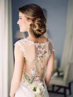 I know this gown is pretty -- but the bride's hair is what we're even more in love with! See more here: http://www.StyleMePretty.com/2014/05/06/garden-romance-in-the-south-of-spain/ #SMP - Photography: Joseba Sandoval - www.romanceweddings.co.uk/