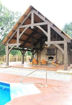Pool House with a Fireplace traditional-pool Cabin Homes, Log Homes, Outdoor Rooms, Outdoor Living, Grange Restaurant, Roof Design, House Design, Timber Frame Homes, Timber Frames