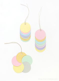 DIY gift tags or ornaments: Colorful cut out circles are great craft material for creating fun patterns and shapes. Glue them together into different shapes in multiple color combinations, punch small holes to tie with string and use as gift tags or ornaments.
