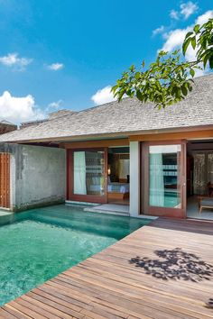 The Santai - Bali, Indonesia - All villas feature an aquamarine-tiled private pool bordered by small trees.