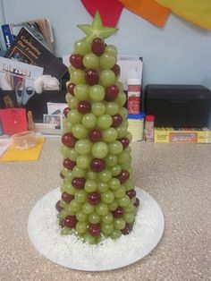 Christmas Tree Snack~~  All you need is a Styrofoam cone, red and green grapes, a star fruit and toothpicks.
