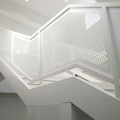 Mild carbon steel perforated sheet with white powder coated is installed on the balustrade railings. Indoor Railing, Metal Stair Railing, Stair Handrail, Staircase Railings, Staircases, Steel Balustrade, Balustrades, Perforated Metal Panel, Stair Paneling