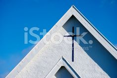 Cross or Crucifix on a Stucco Church Roof royalty-free stock photo Kiwiana, Crucifix, Looking Up, Wind Turbine, Facade, Royalty Free Stock Photos, Culture, Image, Facades