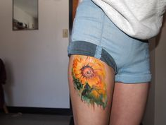 """This is my new watercolor sunflower tattoo. Watercolor technique is not about perfection. When you see it up close it looks slightly messy and unclear but when you see the whole picture from a distance it suddenly becomes clear."""