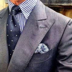 Like this outfit. Different shades of blue and blue striped Shirt. Dark blue tie with dots goes well with the striped shirt. A subtle grey suit. Finished off by a nice pocket scarf. This ensemble works! You will look like a winner!