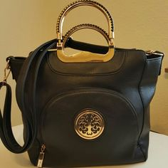 Chasse Wells Black leather w/ gold braided handles Gorgeous black leather Chasse Well purse with beautiful gold accents. Excellent condition with gorgeous gold & black handles. Height 12 1/2, Width 15 1/2 and has a detachable strap as well. Chasse Wells Bags Shoulder Bags