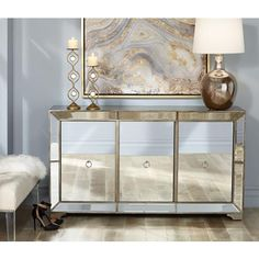Update your dining room in contemporary style with this sophisticated 3-door buffet cabinet that features shining mirrored door fronts.