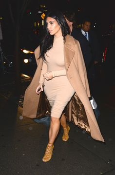 "Kim Kardashian stunned in a camel-colored ensemble out in NYC on Tuesday. The ""Keeping Up With The Kardashians"" star wore an American Apparel dress, a Max Mara coat and Hermes strappy sandals. 