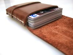 Love the simplicity... Leather Wallet-Men Wallet-Leather Card Holder-Saddle  Brown-Free Monogramming. $25.00, via Etsy.
