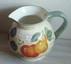 Check out this item in my Etsy shop https://www.etsy.com/listing/537090239/home-trends-cermaic-pottery-pitcher-jug