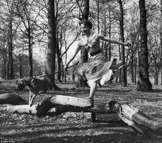 Actress Audrey Hepburn exercises her dog in Richmond Park in a photograph from a collectio...